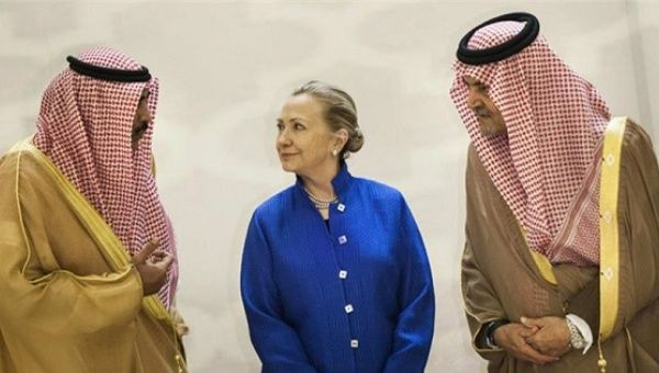 Then U.S. Secretary of State Hillary Clinton speaks with former Saudi Foreign Minister Prince Saud Al-Faisal in Riyadh, Saudi Arabia.