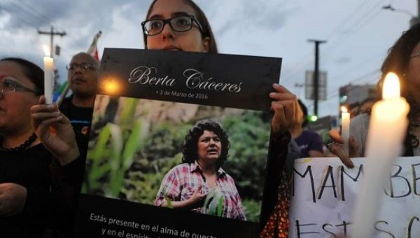 Demonstrators march in memory of murdered Indigenous leader Berta Caceres on International Women