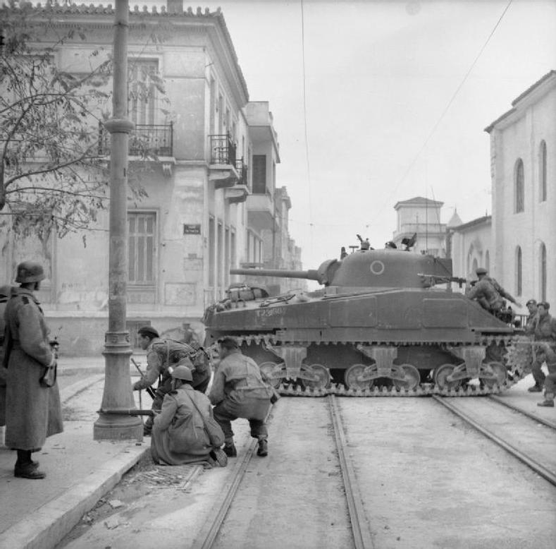 "Sherman tanks and troops from the 5th (Scottish) Parachute Battalion, British 2nd Parachute Brigade, fighting against members of ELAS in Athens, 18 December 1944. Churchill regarded ELAS (Greek People's Liberation Army) and EAM (National Liberation Front) as ""miserable banditti,"" these were the very people who ran the Nazis out. His actions in the month of December were purely out of his hatred and paranoia for communism."