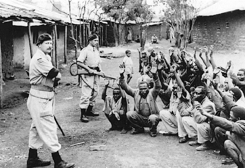 "Hola massacre, Kenya, 1959: 11 Kenyans were clubbed to death by British colonial guards in the Hola 'detention camp'. 150,000 men, women and children were forced into these camps. Rape, castration, cigarettes, electric shocks and fire all used by the British to torture the Kenyan people.  The Cowan Plan advocated the use of force and sometimes death against Kenyan POWs who refused to work.  A cover up followed where the British tried to blame ""contaminated water"" for their deaths."