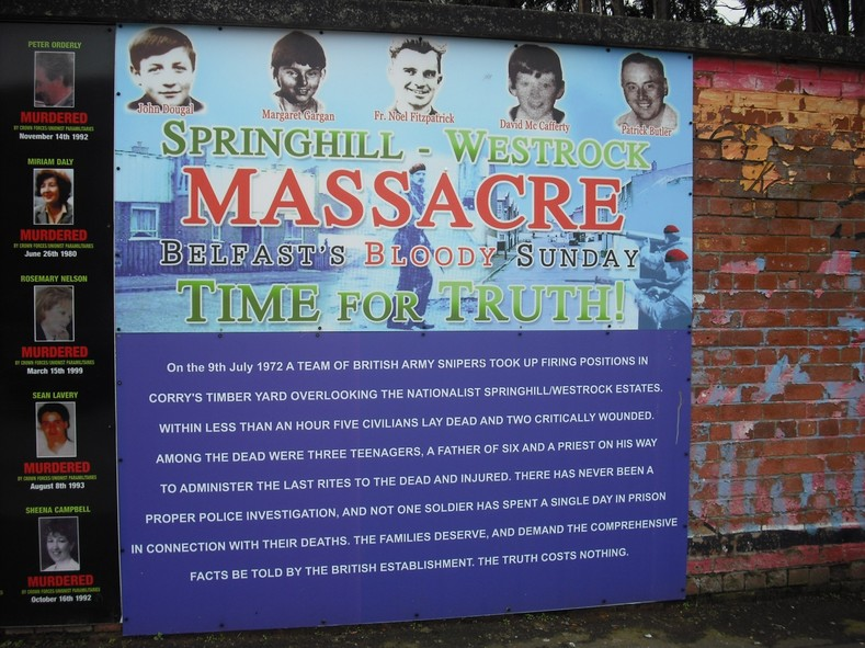 A mural calling for an inquiry into the 1972 Springhill Massacre, Beechmount area of the Falls Road, Belfast On the 9th of July, 1972, 5 people were shot dead by British Army snipers in the Springhill estate in Belfast, Ireland. Three were civilians, including a priest. The two others were members of Fianna Eireann, an Irish revolutionary youth organisation.