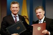 Colombia's President Juan Manuel Santos (R) and Argentina's President Mauricio Macri pose with agreements folders in Bogota Colombia, June 15, 2016.