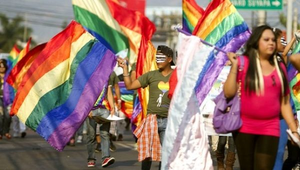 Members of Honduran LGBTQ organizations march in the capital city Tegucigalpa to demands justice for murdered community leaders, May 17, 2013.
