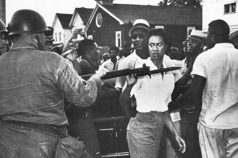 "Gloria Richardson, seen here defiantly pushing aside a National Guard rifle, was a fearless organizer and leader of the Cambridge Movement in Cambridge, Maryland, in the 1960s. The movement evolved into a battle for the economic rights of Cambridge citizens, many of whom were faced with low wages and unemployment. Known as ""Glorious Gloria,"" many considered her to be a tough leader akin to a second Harriet Tubman."