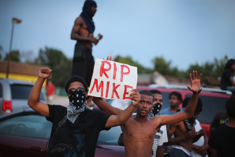 Demonstrators gather along West Florissant Avenue to protest the shooting death of Michael Brown on August 14, 2014 in Ferguson, Missouri. Violent protests have erupted along West Florissant in Ferguson each of the last four nights as demonstrators express outrage over the shooting death of Michael Brown by a Ferguson police officer on August 9.
