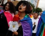 Members of the LGBT community march toward the U.S. Embassy during a vigil in memory of the victims of the Orlando, in Tegucigalpa, Honduras, June 16, 2016.
