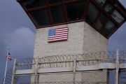 The United States flag decorates the side of a guard tower inside of Joint Task Force Guantanamo Camp VI at the U.S. Naval Base in Guantanamo Bay.