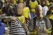 Brazil fans wear masks of FIFA president Sepp Blatter (L) and former Brazilian Soccer Confederation president Jose Maria Marin as they await the start of their team's first round Copa America 2015 soccer match.