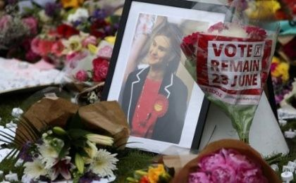 Tributes in memory of murdered Labour Party MP Jo Cox, who was shot dead in Birstall, are left at Parliament Square in London.
