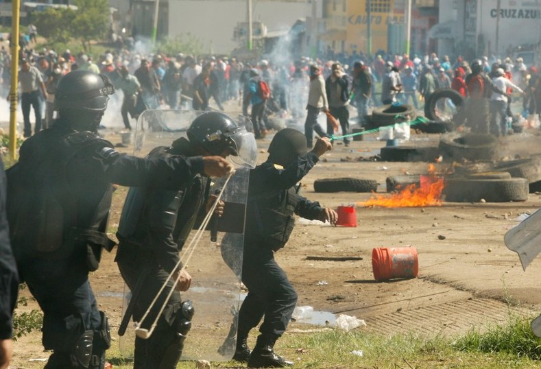Protesters from the National Coordination of Education Workers (CNTE) teachers' union clash with riot police officers during a protest against President Enrique Pena Nieto's education reform, in the town of Nochixtlan, northwest of the state capital, Oaxaca City, Mexico June 19, 2016.