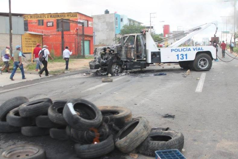 The violence came after seven days of street blockages and protests disrupting traffic on a major highway connecting Oaxaca to Mexico City, the government said.