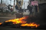 Burning tires and barricades in Oaxaca during clashes between police and striking teachers, June 20, 2016.
