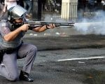 An officer with the Sao Paulo Military Police fires rubber bullets during a protest in Sao Paulo, Brazil, June 1, 2016.