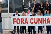 Demonstrators celebrate the suspension of Eduardo Cunha with a sign reading