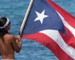 A man waves the flag of Puerto Rico.
