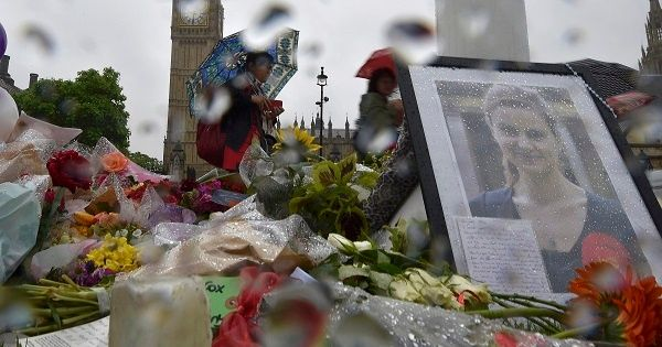 People view tributes in memory of murdered Labour Party MP Jo Cox at Parliament Square in London, June 20, 2016.