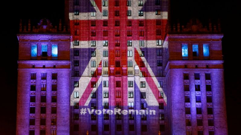 The Palace of Culture and Science is illuminated in Union Jack colours by Warsaw