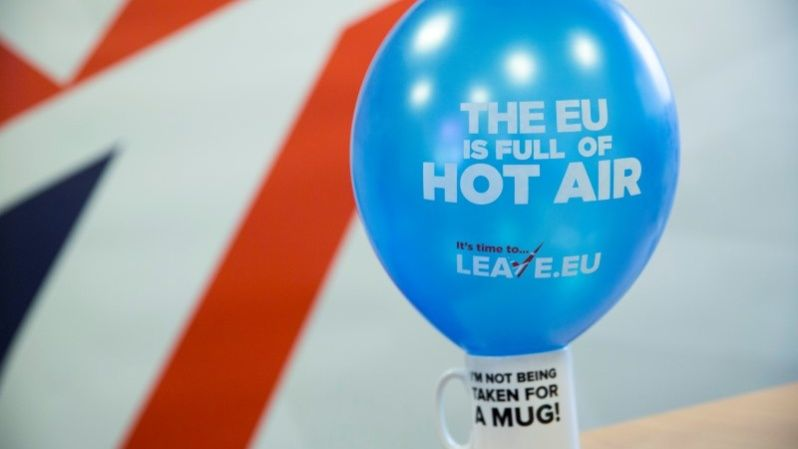 "A branded balloon and mug are seen in the office of pro-Brexit group pressure group ""Leave.eu"" in London, Britain."
