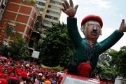 A giant inflatable doll of Venezuela's late President Hugo Chavez is seen during a pro-government rally in Caracas, Venezuela, June 22, 2016.
