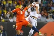 Chile defender Gonzalo Jara (L) heads the ball against Colombia forward Roger Martinez in the Copa America semifinals in Chicago, June 22, 2016.