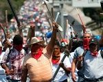 "Thousands of people led by CNTE marched in the capital of the southern state of Oaxaca on Tuesday to denounce the ""massacre"" at the hands of armed police."