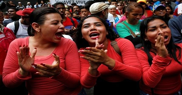 Supporters of President Maduro cheer at a rally against the application of Organization of American States democratic charter in Caracas, June 23, 2016.