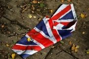 A British flag lies on the street in London.