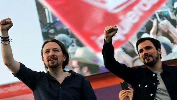Podemos leader Pablo Iglesias (L) and United Left leader Alberto Garzon, during the last campaign rally for Spain