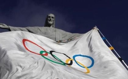The Olympic Flag flies in front of