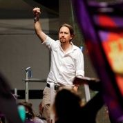 Podemos party leader Pablo Iglesias gestures to supporters after Spain