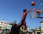 U.S. basketball legend Shaquille O'Neal coaches kids in layup drills and scrimmages during a public clinic in Havana, Cuba, June 26, 2016.