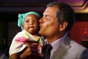 Ecuadorean President Rafael Correa kisses a baby at the Feb. 16, 2016 event to celebrate the signing of the presidential decree for people of African heritage.
