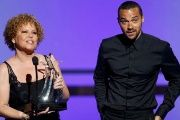 Chairman and CEO of BET Debra Lee presents the Humanitarian Award to actor Jesse Williams during the BET Awards in Los Angeles, California June 26, 2016.