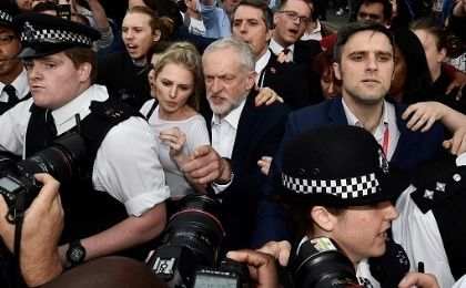 Opposition Labour party leader Jeremy Corbyn (C) arrives to address a gathering of supporters demonstrating in Parliament Square, in central London.