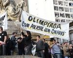 Policemen and protesters holds signs that read