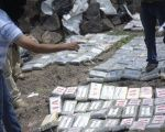 A police officer counts packages containing cocaine during a destruction operation on the outskirts of Tegucigalpa, the Honduran capital.