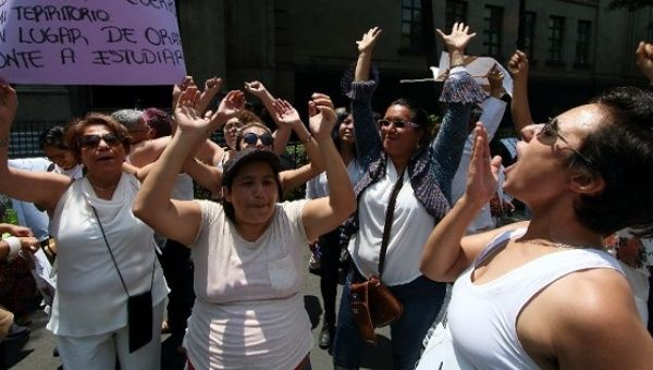 Women demonstrate in of pro-choice legislation as the Supreme Court in Mexico City debates a proposal to decriminalize abortion.