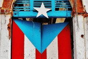 A door painted with the Puerto Rican flag seen in San Juan.