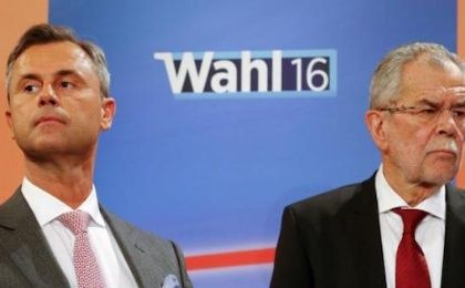 Presidential candidates Alexander Van der Bellen (R) and Norbert Hofer react during a TV debate in Vienna, Austria, April 24, 2016.