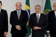 Brazil's interim President Michel Temer and other newly-appointed officials pose for photographers during a meeting at the Planalto Palace in Brasilia.
