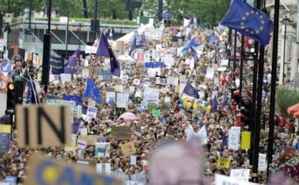 People hold banners during a demonstration against Britain's decision to leave the European Union, in central London, Britain July 2, 2016.