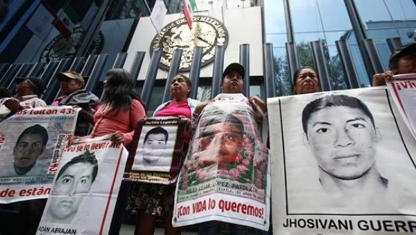 Relatives of the 43 Ayotzinapa students missing protesting in Mexico City