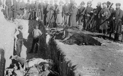 Bodies beings dumped into a mass grave at Wounded Knee. Between 150-300 Lakota men, women and children were killed by U.S Cavalry.