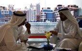 Businessmen speak to each other during the Cityscape real estate exhibition in Dubai October 2, 2012.