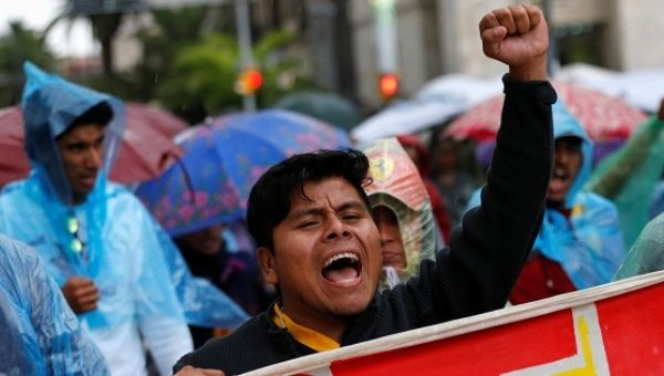 Protesters march against the education reform in Mexico City.
