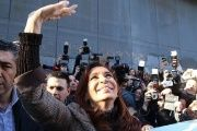 Cristine Fernandez de Kirchner waves to supporters outside a court in Buenos Aires.