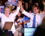 Democratic U.S. presidential candidate Hillary Clinton waves with U.S. Secretary of Housing and Urban Development Julian Castro at her side during a