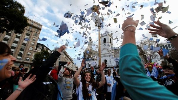 People gather at Plaza de Mayo square during celebrations of the bicentennial anniversary of Argentina