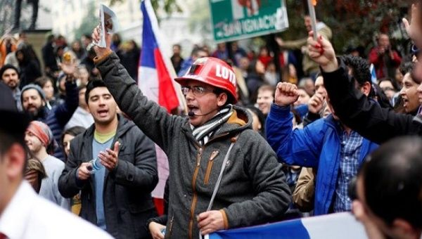 Hundreds of thousands of Chileans marched in over a dozen cities, including the capital Santiago, to demand an end to the country