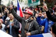Hundreds of thousands of Chileans marched in over a dozen cities, including the capital Santiago, to demand an end to the country's private pension system, July 24, 2016.